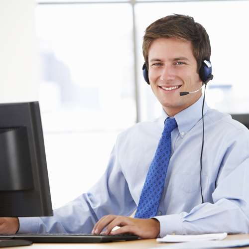 Image of a support professional sitting at a desk with a headset on ready to take your support call